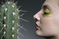 Side profile of a Caucasian woman and a cactus