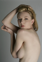 Young woman posing topless