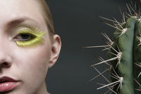 Close-up of a Caucasian woman beside a cactus