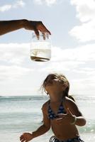 View of a girl looking at jar.