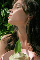Woman facing sun with her eyes closed