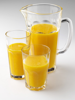 A glass a jug of orange juice and oranges editorial food