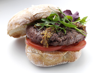 Venison burger in a ciabatta roll editorial food