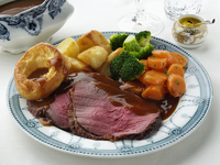 Slices of silverside roast beef dinner in a table setting