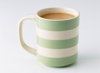 Mug of tea on a white background