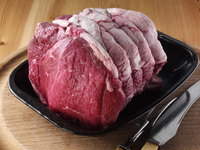 A joint of raw beef topside in a roasting dish