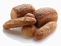 Loaves of bread and rolls on a white background