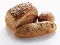 Multigrain loaf and rolls on a white background