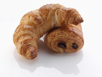 A pain au chocolat and croissant on a white background