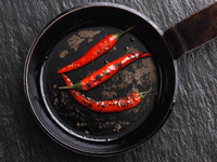 Flamed red chili peppers chillies