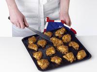 Chicken tikka on a baking sheet
