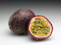 Whole passion fruit and half cut with seeds