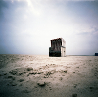 Germany, North Sea, Amrum, Roofed wicker beach chair on the beach