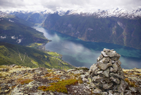 Norway, Fjord Norway, Aurlandsfjord, heap of stones in foreground