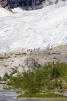 Norway, Nigardsbreen, Tourists on glacier tongue
