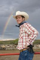 USA, Texas, Dallas, Cowboy standing by pasture, smiling, portrait