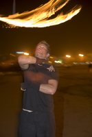 Spain, Canary Islands, Gran Canaria, Young man juggling with torches