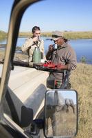 Africa, Botswana, Okavango Delta, Men on safari having a break