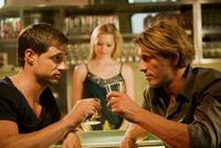 Two Men toasting at bar
