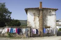 Bosnia and Herzegovina, Medjugorje, Clothes for sale hanging on line