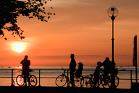 Austria, Bregenz, Silhouettes of  Bicyclists at Lake Constance,