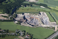 Germany, Rhineland-Palatinate, Eifel, Laacher See, Aerial view of volcanic basalt quarry with highway A 61