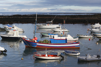 Spain, Canary Islands, Lanzarote, Orzola, View of boats on sea