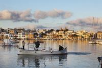Spain, Balearic Islands, Majorca, Portocolom, Fishermen in boat on river