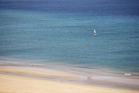 Spain, Canary Islands, Fuerteventura, Jandia, Windsurfer in sea at sotavento beach