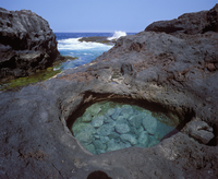 Spain, Canary Islands, El Hierro, Charco Manso, View of sea with rock formation