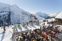 Austria, Vorarlberg, Damuls, People at Sonnenhof Sonnenalm restaurant and ski hut in winter