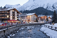 Austria, Vorarlberg, Lech am Arlberg, View of hotels and Lech river in winter