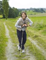 Germany, Munich, Mature woman nordic walking, smiling, portrait 20025328741| 写真素材・ストックフォト・画像・イラスト素材|アマナイメージズ