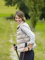 Germany, Munich, Mature woman nordic walking, smiling, portrait 20025328743| 写真素材・ストックフォト・画像・イラスト素材|アマナイメージズ