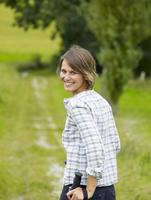 Germany, Munich, Mature woman nordic walking, smiling, portrait 20025328744| 写真素材・ストックフォト・画像・イラスト素材|アマナイメージズ