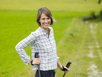 Germany, Munich, Mature woman nordic walking, smiling, portrait 20025328745| 写真素材・ストックフォト・画像・イラスト素材|アマナイメージズ