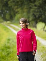 Germany, Munich, Mature woman nordic walking, smiling 20025328756| 写真素材・ストックフォト・画像・イラスト素材|アマナイメージズ