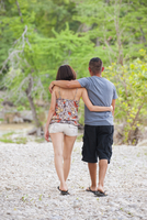 USA, Texas, Leakey, Young couple walking on gravel
