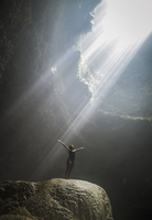 Indonesia, Young woman looking at sunbeam