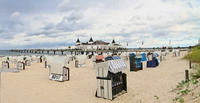 Germany, Usedom, Ahlbeck, View of hooded beach chairs by lake