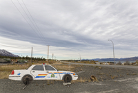 Canada, Police car dummy for speed reducing at Destruction Bay