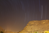 Spain, La Gomera, Star trails over mountain