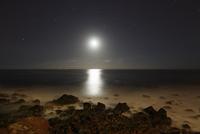Spain, La Gomera, View from beach of Valle Gran Rey over moonlit sea