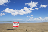 New Zealand, View of sign board at Ninety Mile Beach