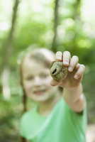 Germany, Bavaria, Munich, Girl showing snail