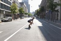 Germany, North Rhine Westphalia, Duesseldorf, Mid adult man riding skateboard