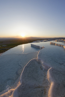 Turkey, View of Travertine terraces of Pamukkale at sunset