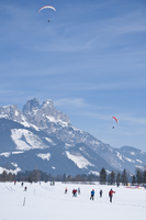 Austria, Tourists are skiing and paraglider flying at Tannheim Alps