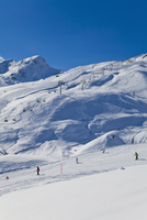 Switzerland, Carmenna, people sking in snow, chair lift in background