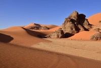 Algeria, Sahara,  Tassili N'Ajjer National Park, Tadrart, rocks and sand dunes at Tin Merzouga